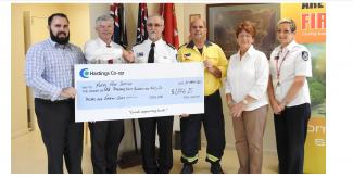 Presentation of cheque to the RFS from a fundraiser held by the Hastings Co-op for $ 1846.15