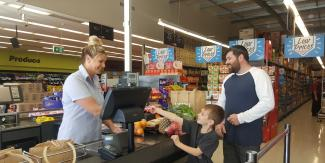 Kylie serving customers at Wauchope IGA