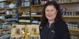 Alisan displaying a Bago Bluff hamper at Wauchope Department Store